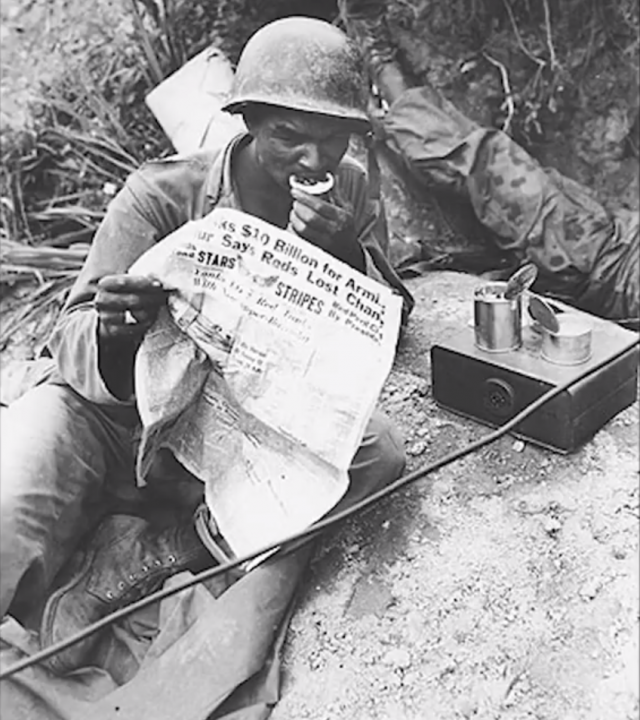 deployed soldier reading stars and stripes
