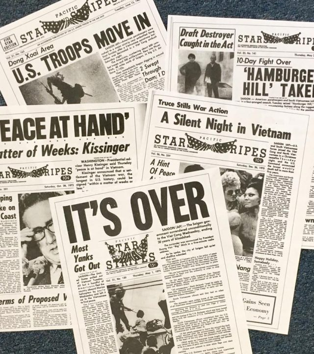 Stars and Stripes newspapers spread out on the floor