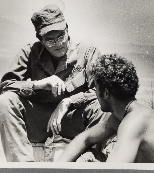 Stars and Stripes reporter speaking with a soldier